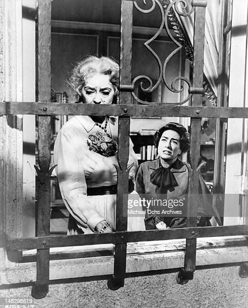 Bette Davis looking out the window as Joan Crawford pleads with her in a scene from the film 'What Ever Happened To Baby Jane' 1962