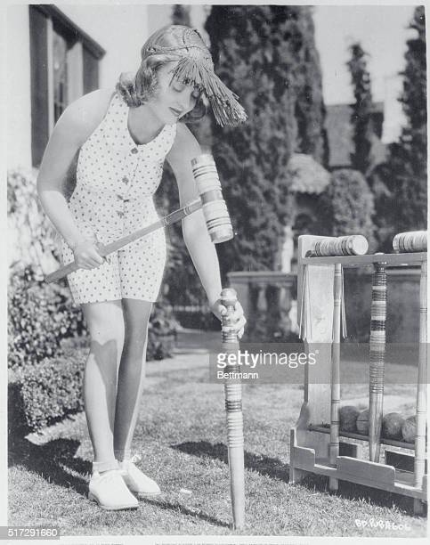 Bette Davis prominent film actress and reputed to be the film colony's champion croquet player pictured at her Hollywood California home as she set...