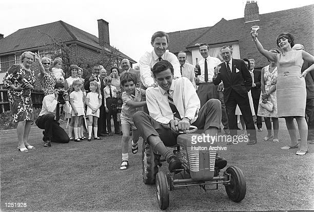 Bette Hill throws her husband motor racing ace Graham a party to celebrate his homecoming from America where he won the Indianapolis 500 in a...