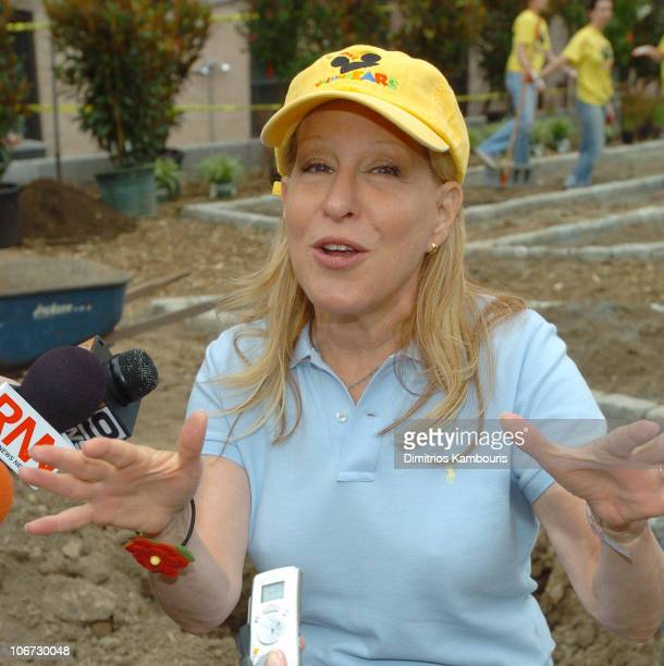 Bette Midler during Michael Eisner and Disney VoluntEARS Join Bette Midler and her New York Restoration Project to Revitalize East Harlem Community...