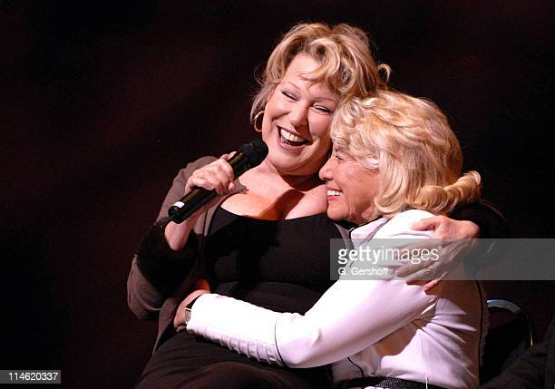 Bette Midler sitting on lap of Liz Smith honoree