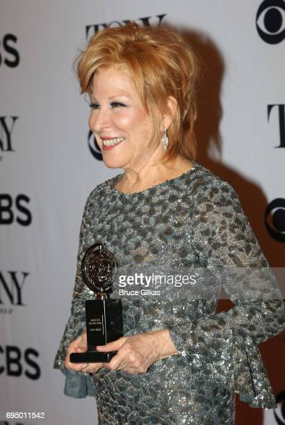 """Bette Midler, winner of the award for Best Actress in a Musical for """"Hello, Dolly!,"""" poses in the press room during the 2017 Tony Awards at 3 West..."""