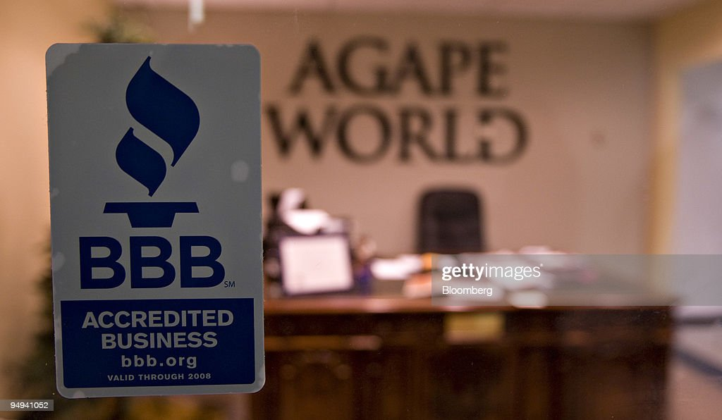 A better business bureau accredited business sticker hangs on the window outside the lobby of the