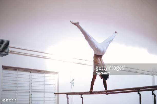 better by the day - parallel bars gymnastics equipment stock photos and pictures