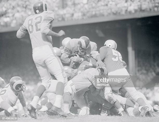 Better Late Than Never. Detroit, Michigan: Dan Towler of the Los Angeles Rams goes over the top of the line to score the first Ram touchdown in the...