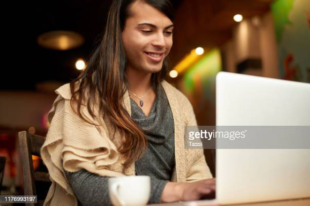 i better make use of this free wifi - gender fluid stock pictures, royalty-free photos & images