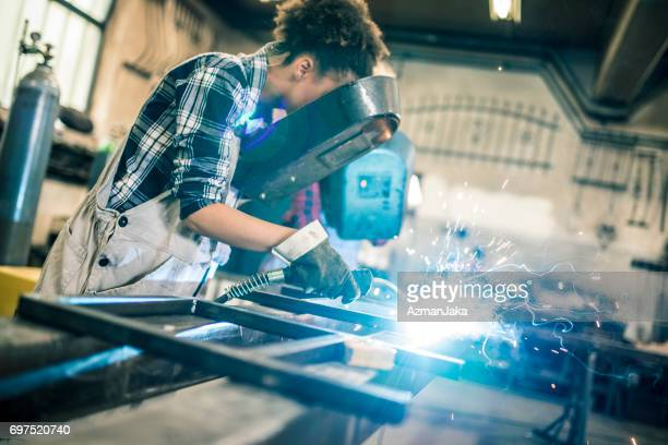 better than any man - welding stock photos and pictures