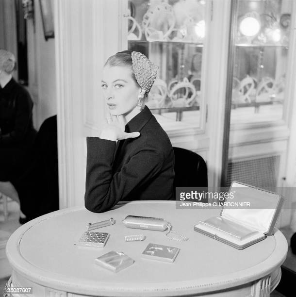 Bettina, famous top-model trying jewels in the Jewelry Cartier, place Vendome, Paris in 1953. Cartier was founded in Paris in 1847 by Louis-Francois...