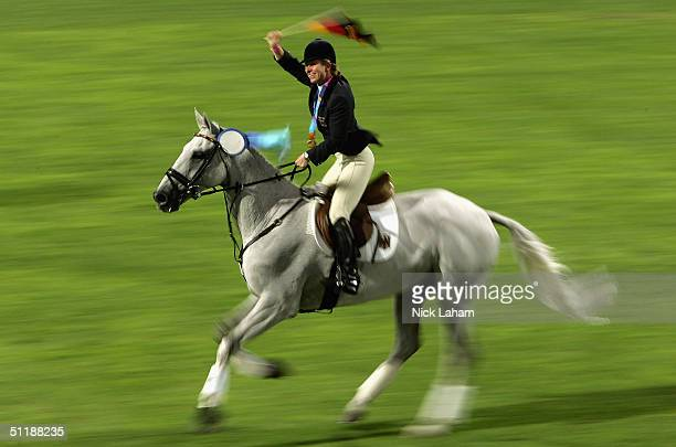 Bettina Hoy of Germany rides her horse Ringwood Cockatoo after receiving the gold medal in the individual three day eventing competition on August 18...