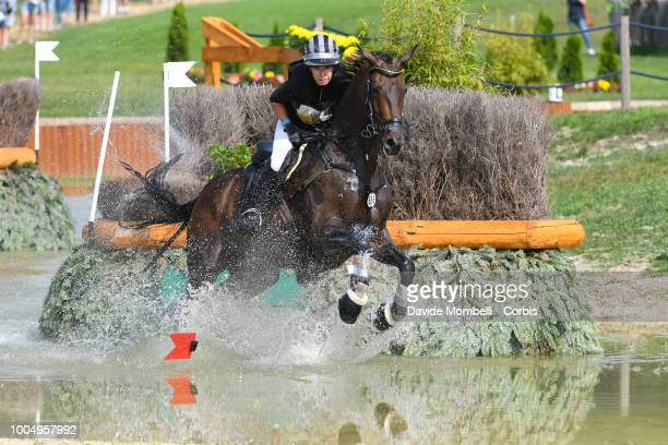 Bettina Hoy of Germany riding Designer 10 during the obstacle in the water of the Cross Country test DHLPrize in the park of the CHIO of Aachen on...
