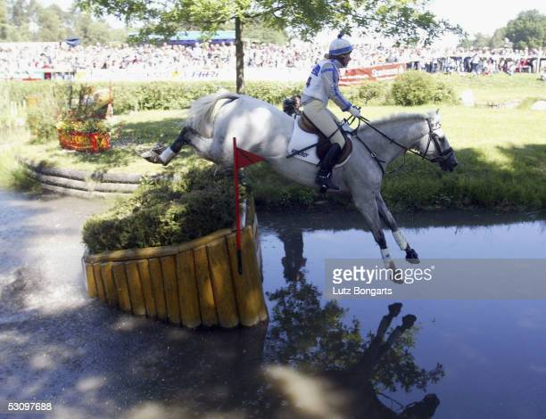 Bettina Hoy of Germany riding Ringwood Cockatoo jumps into the water at the CCI Cross country Milford Trophy on June 18 2005 in Luhmuehlen Germany