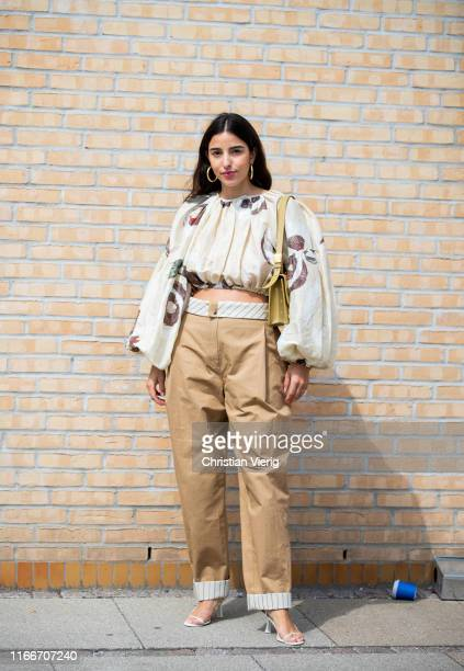 Bettina Looney is seen wearing beige pants outside Holzweiler during Copenhagen Fashion Week Spring/Summer 2020 on August 07 2019 in Copenhagen...