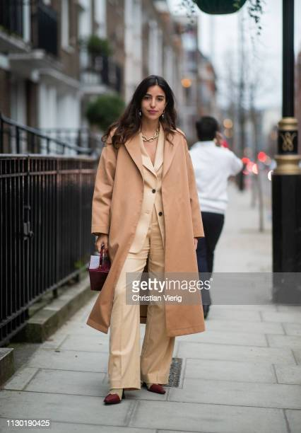 Bettina Looney is seen wearing beige suit and coat outside Toga during London Fashion Week February 2019 on February 16 2019 in London England