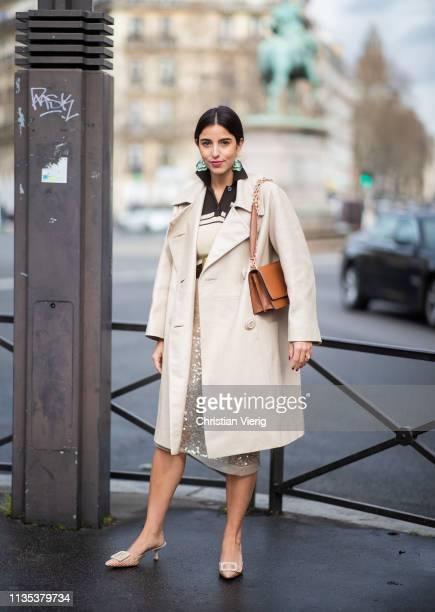 Bettina Looney is seen wearing coat outside Miu Miu during Paris Fashion Week Womenswear Fall/Winter 2019/2020 on March 05 2019 in Paris France