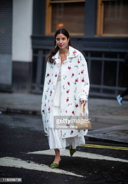 Bettina Looney is seen wearing coat with flora print outside REJINA PYO during London Fashion Week February 2019 on February 18 2019 in London England