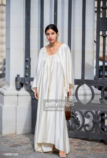Bettina Looney is seen wearing creme white dress outside Designers Remix during Copenhagen Fashion Week Spring/Summer 2020 on August 08, 2019 in...