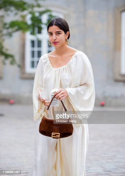 Bettina Looney is seen wearing creme white dress outside Designers Remix during Copenhagen Fashion Week Spring/Summer 2020 on August 08 2019 in...