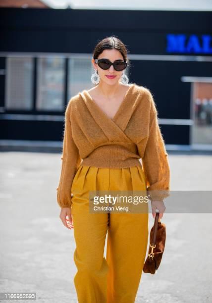 Bettina Looney is seen wearing mustart v neck knit pants outside By Malene Birger during Copenhagen Fashion Week Spring/Summer 2020 on August 08 2019...