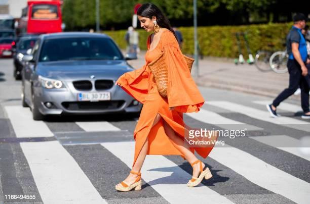 Bettina Looney is seen wearing orange dress outside Mykke Hofmann during Copenhagen Fashion Week Spring/Summer 2020 on August 06 2019 in Copenhagen...
