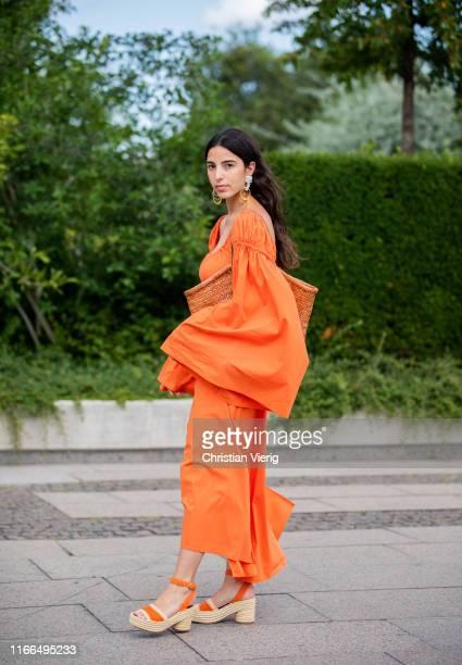 Bettina Looney is seen wearing orange dress with wide sleeves bag outside Mykke Hofmann during Copenhagen Fashion Week Spring/Summer 2020 on August...
