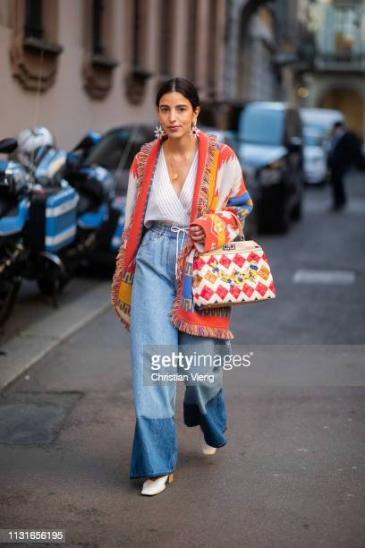 Bettina Looney is seen wearing two tone denim jeans Fendi bag cardigan outside Vivetta on Day 2 Milan Fashion Week Autumn/Winter 2019/20 on February...