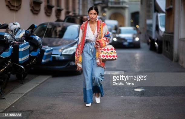 Bettina Looney is seen wearing two tone denim jeans Fendi bag cardigan outside Vivetta on Day 2 Milan Fashion Week Autumn/Winter 2019/20 on February...