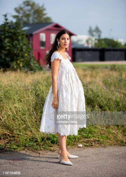 Bettina Looney is seen wearing white dress outside Cecilie Bahnsen during Copenhagen Fashion Week Spring/Summer 2020 on August 07 2019 in Copenhagen...