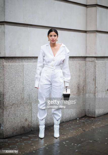 Bettina Looney is seen wearing white striped overall bag outside Pringle of Scotland during London Fashion Week February 2019 on February 18 2019 in...