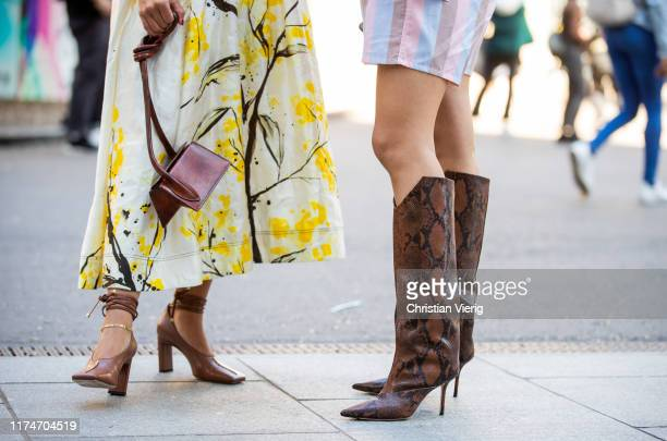 Bettina Looney is seen wearing yellow white dress with graphic print brown bag outside Ports 1961 during London Fashion Week September 2019 on...