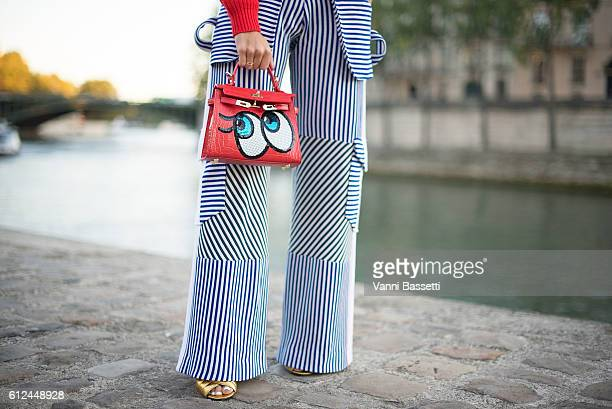 Bettina Looney poses wearing an H and M jumper Richard Malone pants Play No More bag and Gucci shoes before the Paul and Joe show at Les Nautes...