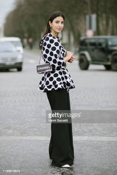 Bettina Looney poses wearing Chanel after the Chanel show at the Grand Palais during Paris Fashion Week Womenswear Fall Winter 2019/2020 on March 05...