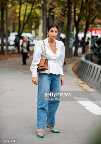 Bettina Looney seen wearing white blazer denim jeans outside Elie Saab during Paris Fashion Week Womenswear Spring Summer 2020 on September 28 2019...