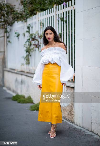 Bettina Looney seen wearing white off shoulder top, yellow skirt, white bag outside the Missoni show during Milan Fashion Week Spring/Summer 2020 on...