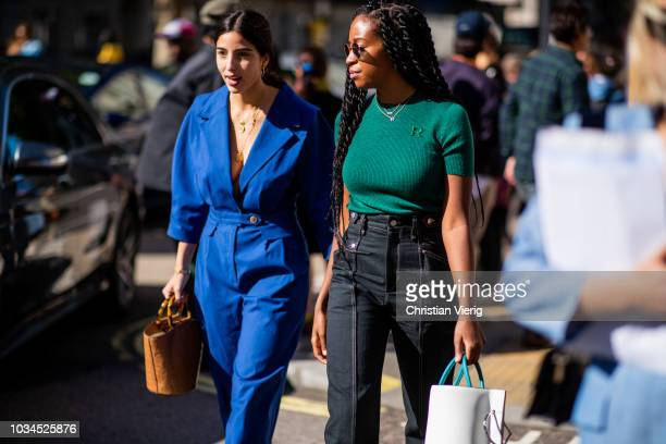 Bettina Looney wearing blue overall is seen outside Delpozo during London Fashion Week September 2018 on September 16 2018 in London England