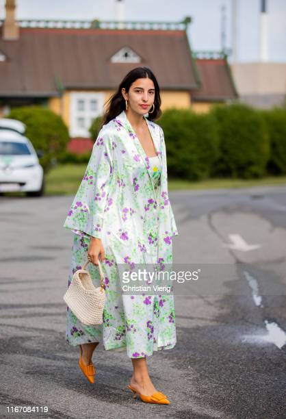 Bettina Looney wearing coat with floral print dress outside Stine Goya during Copenhagen Fashion Week Spring/Summer 2020 on August 08 2019 in...