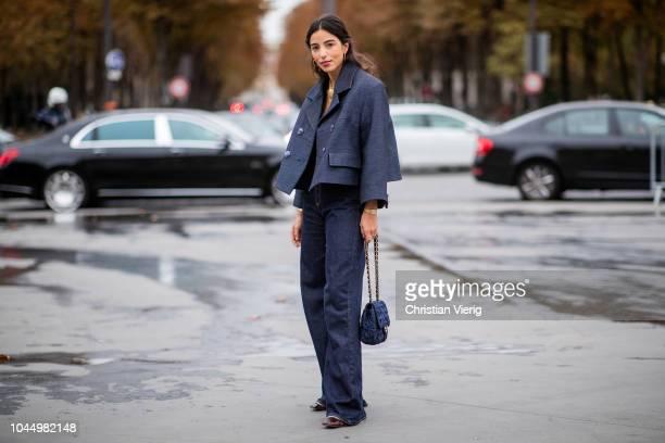 Bettina Looney wearing cropped jacket dark blue denim jeans is seen outside Chanel during Paris Fashion Week Womenswear Spring/Summer 2019 on October...