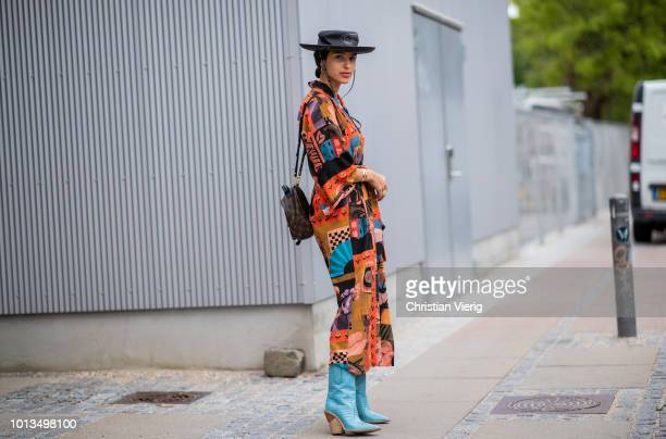 Bettina Looney wearing Dior hat dress with print is seen outside Stine Goya during the Copenhagen Fashion Week Spring/Summer 2019 on August 8 2018 in...