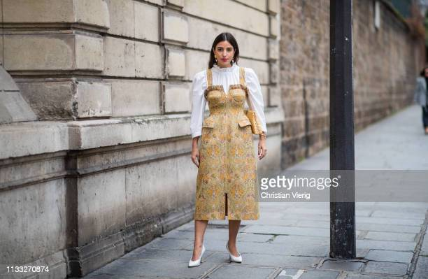 Bettina Looney wearing golden dress white blouse outside Elie Saab during Paris Fashion Week Womenswear Fall/Winter 2019/2020 on March 02 2019 in...