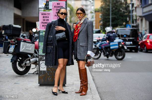 Bettina Looney wearing grey pants red scarf mini skirt bag brown boots and Anna Rosa Vitiello wearing dark grey coat black belt bag cycle pants...