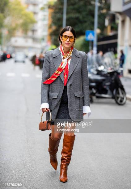 Bettina Looney wearing grey skirt, mini skirt, bag, red scarf brown boots outside the Max Mara show during Milan Fashion Week Spring/Summer 2020 on...