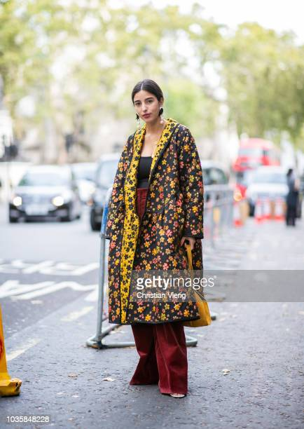 Bettina Looney wearing oversized coat with floral print is seen outside Richard Quinn during London Fashion Week September 2018 on September 18 2018...