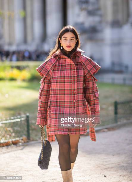 Bettina Looney wearing red checked jacket tights beige boots is seen outside Elie Saab during Paris Fashion Week Womenswear Spring/Summer 2019 on...