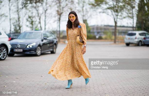 Bettina Looney wearing yellow dress seen outside Holzweiler during the Copenhagen Fashion Week Spring/Summer 2019 on August 8, 2018 in Copenhagen,...