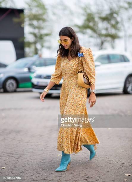 Bettina Looney wearing yellow dress seen outside Holzweiler during the Copenhagen Fashion Week Spring/Summer 2019 on August 8 2018 in Copenhagen...