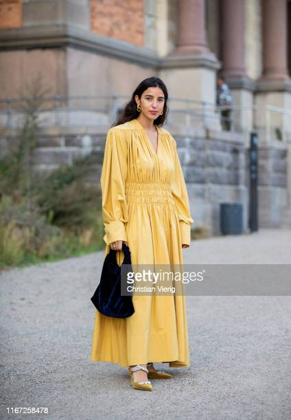 Bettina Looney wearing yellow dress seen outside Samsøe Samsøe during Copenhagen Fashion Week Spring/Summer 2020 on August 07 2019 in Copenhagen...