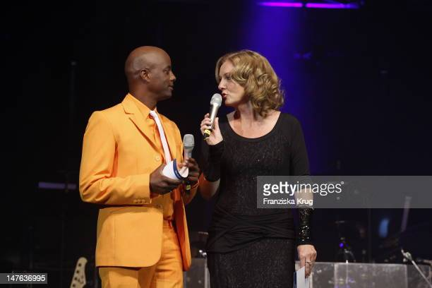 Bettina Tietjen and Yared Dibaba attends the Ship christening of `Mein Schiff 2` on April 14, 2011 in Hamburg, Germany.