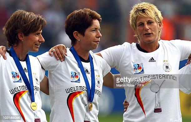 Bettina Wiegmann assistant coach Maren Meinert head coach and Silke Rottenberg goalkeeper coach of Germany celebrate after winning the 2010 FIFA...
