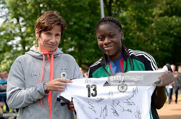 Bettina Wiegmann honors the best goalgetter in tournament Nicole Anyomi of Niederrhein during the U14 girls federal cup at Sportschule Wedau on June...