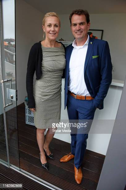 Bettina Wulff and her boyfriend JanHenrik Behnken attend the Audi Ascot Race Day at Neue Bult horse racing track on August 18 2019 in Langenhagen...