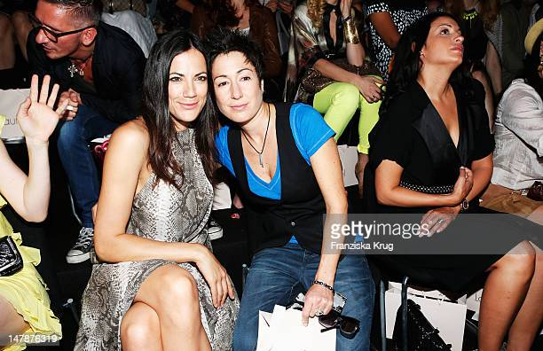 Bettina Zimmermann and Dunja Hayali sit in the front row of the runway at the Laurel Show during the MercedesBenz Fashion Week Spring/Summer 2013 on...